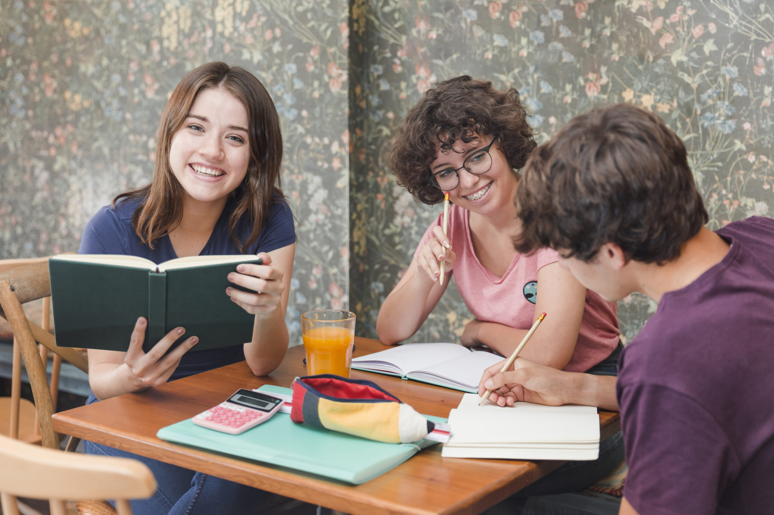 teenager-with-book-near-studying-friends